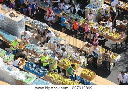 Athens, Greece - May 03, 2015: Marathon Runners Refreshment Station Drinks And Bananas In Athens, Gr