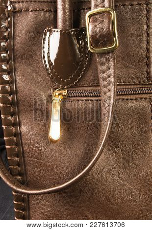 Closeup Of Buckles, Clasps, Zippers, Pockets, Fasteners, Fittings And Seams On Brown Leather Hand Ba