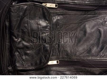 Closeup Of Buckles, Clasps, Zippers, Pockets, Fasteners, Fittings And Seams On The Black Leather Han