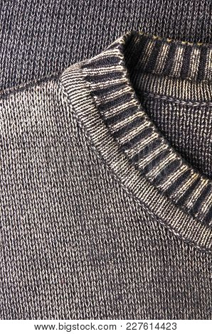 Texture Of A Washed Thick Knit Fabric, With Decorative Elements, Seams And Stitching, Close-up