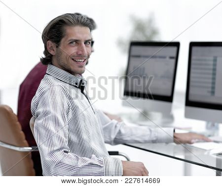business partners are working on the computer