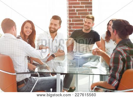 handshake of business partners sitting at the table