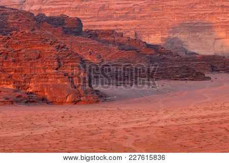 Red Stone Walls Of The Canyon Of Wadi Rum Desert In Jordan. Wadi Rum Also Known As The Valley Of The