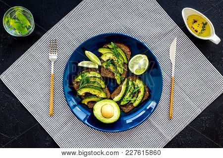 Idea For A Healthy And Nutritious Breakfast. Plate With Avocado Toast With Wholegrain Bread On Black