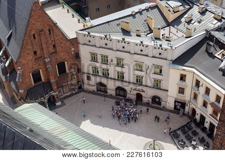 Krakow, Poland - May 29, 2016: Tourist Group Of People Near The St. Mary's Basilica, Waiting For The