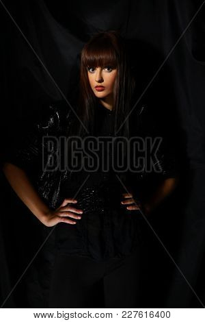 Glamorous modern young woman in a black leather jacket