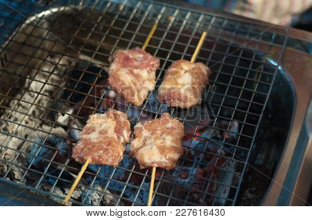 Close Up Grilled Pork Stick Cooking Night Market, Thai Cuisine Traditional Signature Street Food, Qu