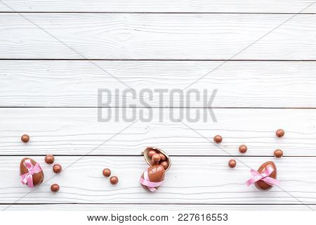 Chocolate Easter Eggs As Little Gift. White Wooden Background Top View.