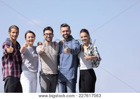 group of young people showing thumb up