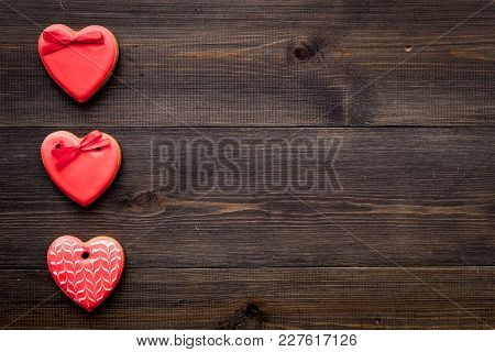 St Valentine's Day Cookies In Shape Of Heart On Dark Wooden Background Top View Copy Space