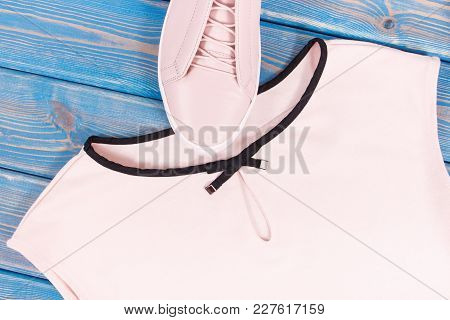 Womanly Clothing And Accessories On Old Boards, Pink Leather Shoes And Shirt