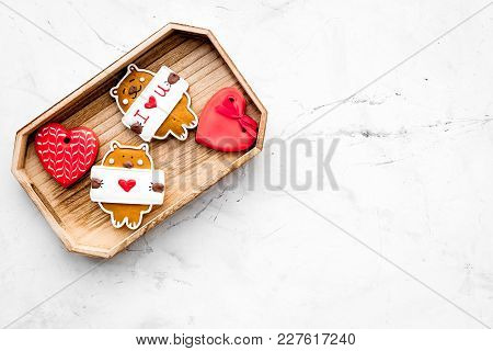 Sweet Gift For St Valentine's Day. Heart Shaped Gingerbread In Tray On Light Grey Background Top Vie