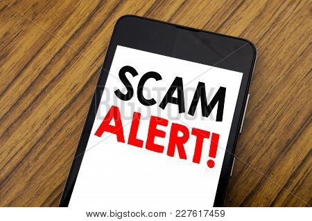 Word, Writing Handwriting Scam Alert. Business Concept For Fraud Warning Written On Mobile Phone, Wo