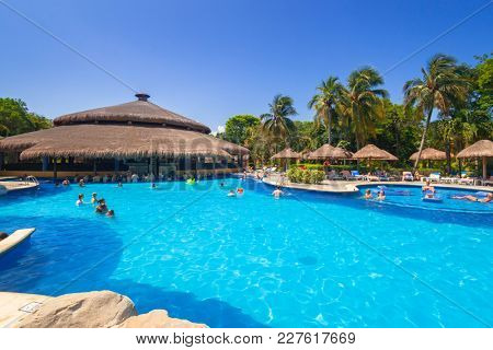 PLAYA DEL CARMEN, MEXICO - JULY 14, 2011: Scenery of luxury swimming pool at RIU Tequila Hotel in Playa del Carmen, Mexico. RIU Hotels & Resorts has more than 100 hotels in 19 countries.