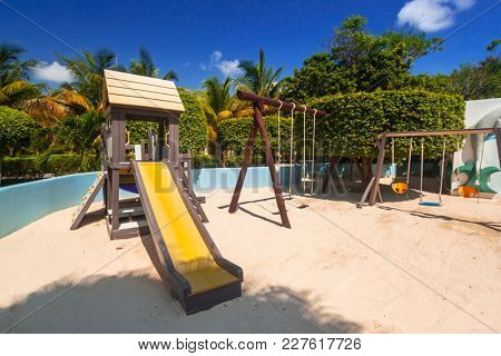 PLAYA DEL CARMEN, MEXICO - JULY 14, 2011: Playground for kidsl at RIU Tequila Hotel in Playa del Carmen, Mexico. RIU Hotels & Resorts has more than 100 hotels in 19 countries.