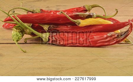 Shrinking And Mould Chili Peppers On White Wooden Background. Rotten Chili Peppers.