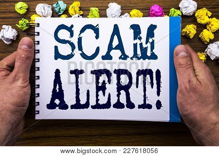 Writing Text Showing Scam Alert. Business Concept For Fraud Warning Written Notepad Notebook Book On