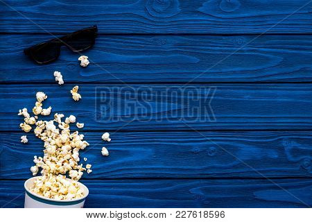 Cinema Accessories. Cinema Glasses And Popcorn On Blue Background Top View.