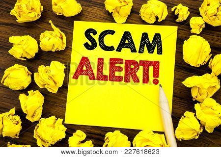 Writing Text Showing Scam Alert. Business Concept For Fraud Warning Written On Sticky Note Paper, Wo