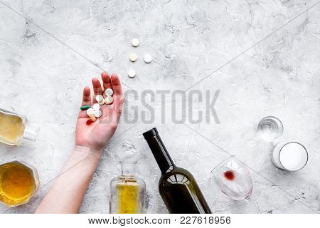Hungover Syndrome. Alcoholism. Glass, Bottle And Pills On Grey Background Top View.