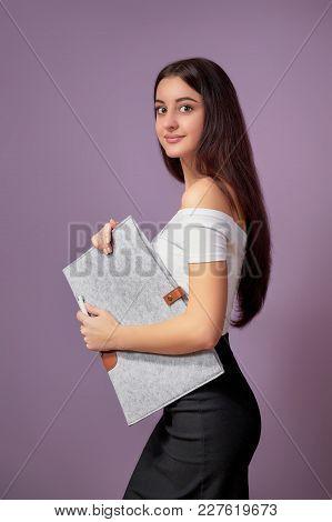 Girl Brunette Asian. Girl Brunette Asian Holding Folder Isolated Purple Background. Portrait Beautif