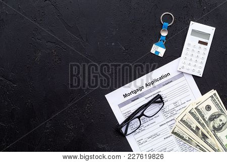 Housing Loan. Draw Up A Mortgage. Mortgage Application Near Keychain In Shape Of House And Money On