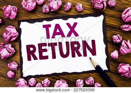 Hand Writing Text Caption Inspiration Showing Tax Return. Business Concept For Taxation Refund Writt