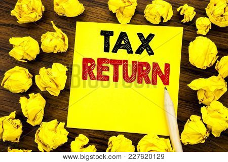 Writing Text Showing Tax Return. Business Concept For Taxation Refund Written On Sticky Note Paper,