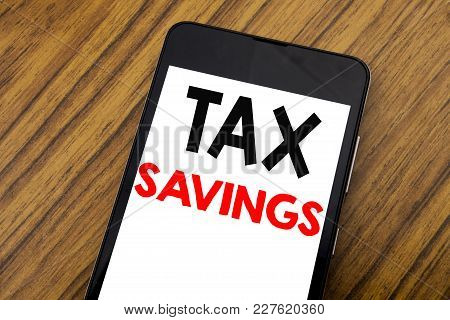 Word, Writing Handwriting Tex Savings . Business Concept For Tax Savings Extra Money Refund Written