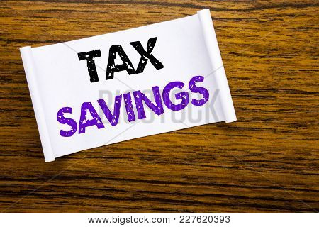 Word, Writing Tex Savings . Business Concept For Tax Savings Extra Money Refund Written On Sticky No