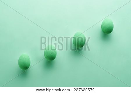 Easter Eggs On A Pastel Green Background. Easter Concept In Pastel Colors. Top View. Flat Lay. Punch