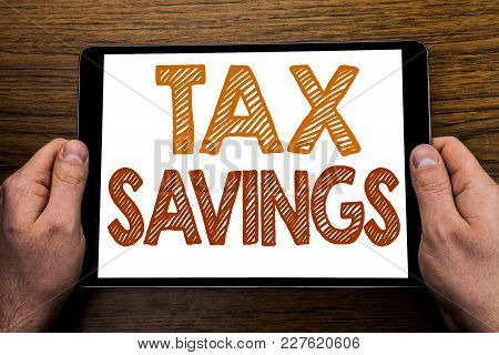 Hand Writing Text Caption Tex Savings . Business Concept For Tax Savings Extra Money Refund Written