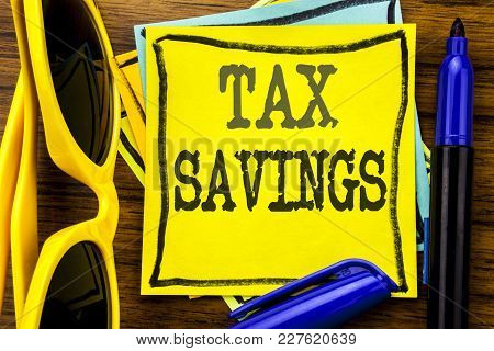 Hand Writing Text Caption Inspiration Showing Tex Savings . Business Concept For Tax Savings Extra M