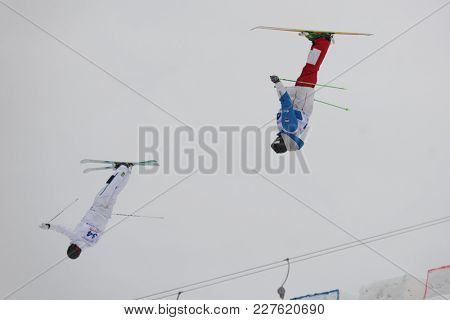 KRASNOE OZERO, LENINGRAD REGION, RUSSIA - FEBRUARY 1, 2018: Anton Latyshev (41) of Russia and Oskar Elofsson of Sweden compete in dual mogul during Freestyle Europa Cup competitions. Elofsson won gold