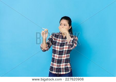 Lady Holding Cigarette Standing In Blue Background
