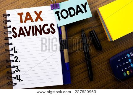 Word, Writing Tex Savings . Business Concept For Tax Savings Extra Money Refund Written On Book Note