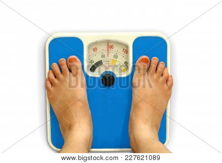 Women Foot Standing On Weighing Scale To Measure Bmi