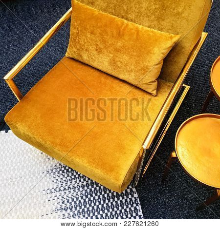 Dark Yellow Velvet Armchair And Golden Side Table. Modern Furniture With Retro Feel.