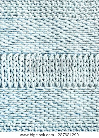 Light Blue Winter Knitted Background With Simple Ornament.