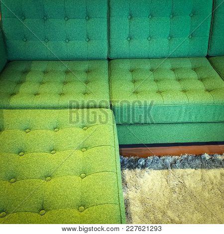 Comfortable Green Corner Sofa On Fluffy Rug. Modern Design.