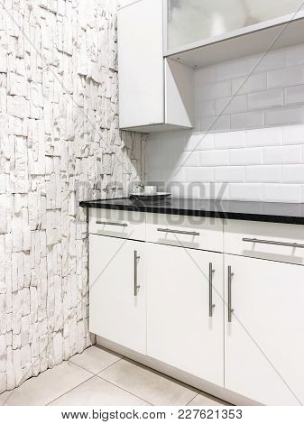 Contemporary Kitchen With White Cabinets And Walls. Home Renovations.