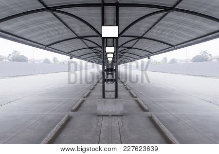 Perspective Of Outdoor Empty Parking Lot With Steel Tube Structure And Metal Sheet Roof, Blank Sign