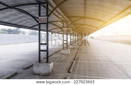 Perspective Of Outdoor Empty Parking Lot With Steel Tube Structure And Metal Sheet Roof At Sunlight