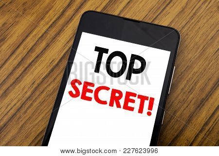 Word, Writing Handwriting Top Secret. Business Concept For Military Top Secret Written On Mobile Pho