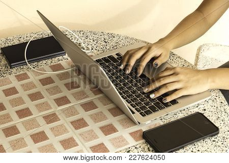 Hands Of Young Girl Working On Laptop Computer
