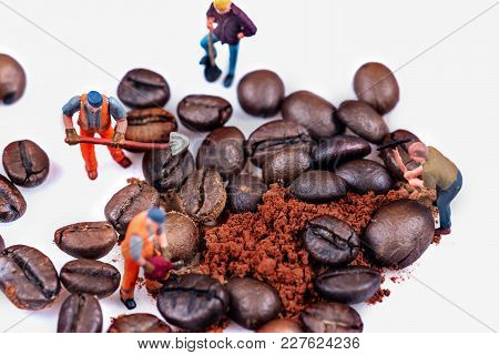 Miniature Figures Working On Coffee Macro Photography On White Background
