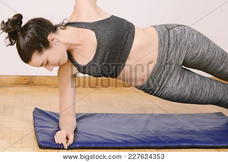 Fitness Woman Doing Crunches At Gym. Sport Concept. Indoors