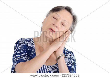 Portrait Of Senior Woman Falling Asleep. Isolated White Background
