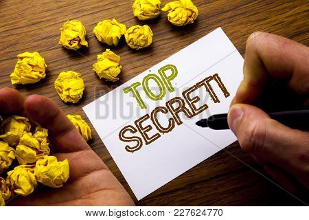 Word, Writing Top Secret. Concept For Military Top Secret Written On Notebook Note Paper On Wooden B
