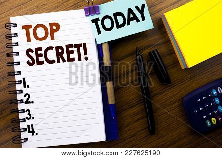 Word, Writing Top Secret. Business Concept For Military Top Secret Written On Book Note Paper On Woo